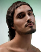 Men funky hairstyle with medium short bangs cross and medium long hair with layers in the back.PNG