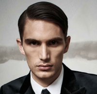 Sexy classic men haircut with slicked on the sides and bang.PNG