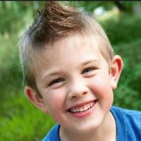 2015 kids cool hairstyles with spiky hair on the top and short hair on the sides.JPG