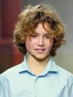 Boys long curly hairstyles with full curls and long curly bangs.JPG