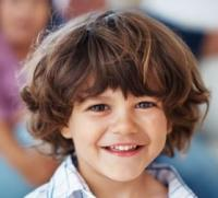 Kids curly long hairstyle with long bangs.JPG