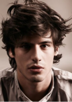 Men sexy hairstyle with full of layers and waves with long bangs.PNG