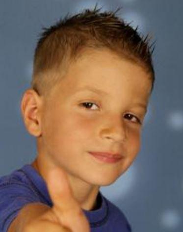 very short little boy haircut with short spiky hair on the