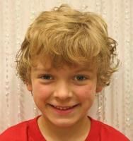 Wavy little boy haircuts photos with long wavy bang.JPG