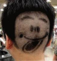 Unique haircut with happy face tongue sticking out.JPG