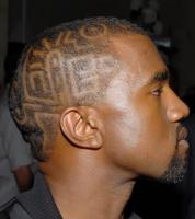 Black male celebrity haircut with undercut hair with cool patterns.JPG