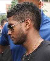 African American male celebrity haircut with cool African curly mohawk.JPG
