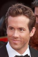 Ryan Reynolds image with short hairstyle with wavy bang pulled up.JPG
