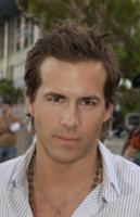 Ryan Reynolds with his medium layered hairstyle with spiky bangs.JPG