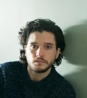 Kit Harington post picture with his medium waves and wavy side bangs.JPG