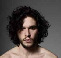 Sexy British actor Kit Harington with his curly haircut with curly side bangs.JPG