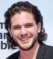 Kit Harington photo with his wavy haircut in medium hairstyle hair pulled back.JPG