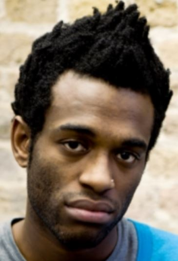 Black men cool hairstyle with funk hairstyle with spiky hair top.JPG