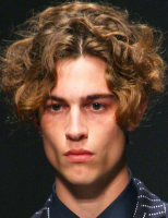 2013 man curly haircut with big wavy curls with very long side bangs and very short in the back.PNG