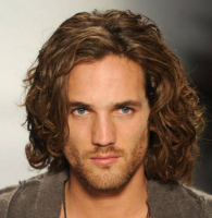 Trendy men long curly haircuts with very long wavy bangs.PNG
