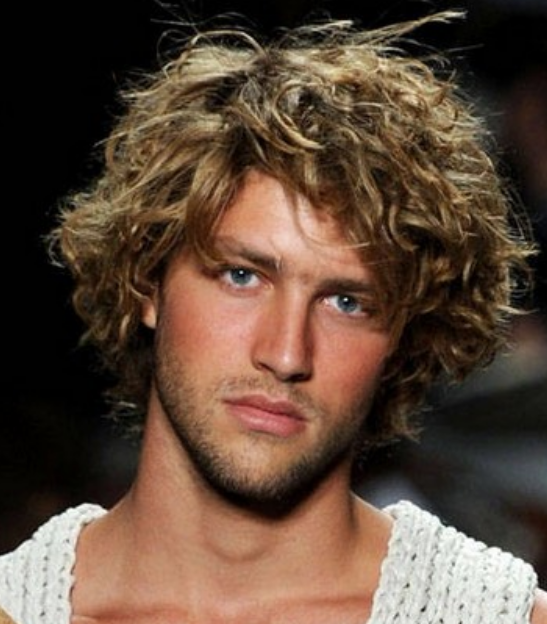 Hot men hairstyles with light curls and full of volume and long bangs.PNG