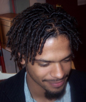 Black men hairstyle with tight curls and medium long hair length with very long side bangs.PNG