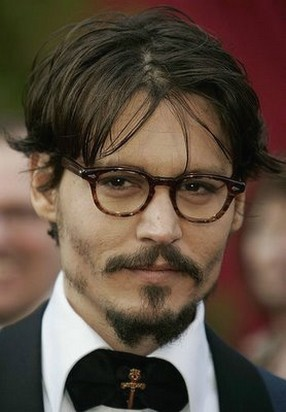 Johnny Depp medium hairstyle with long side bangs.jpg