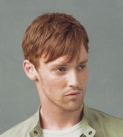 men red hairstyle with long side bangs.jpg
