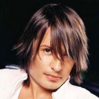 cool men layered hairstyle with long side bangs with twotones.jpg