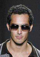 men short fashionable hairstyle wearing very cool sunglasses