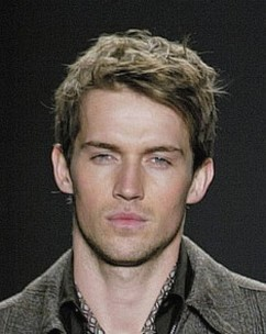 Image of short messy haircut men with wavys and layers on the top