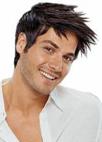 Man's Medium Haircut with layered long bangs in dark brown