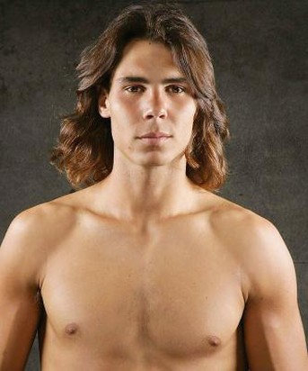 Rafael Nadal with medium long curly hairstyle with long side bangs.jpg