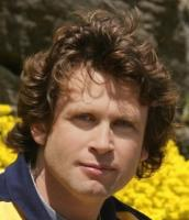 Medium hair style for man with curly hair.jpg