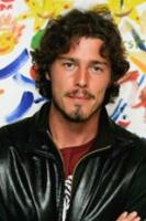 Marat Safin with wavy and curly hair in medium length