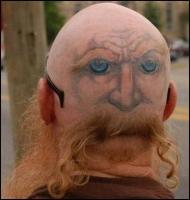 Funny haircut and tattoo combination - eyes in the back of the head.jpg