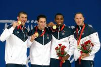 Michael Phelps, Garrett Weber-Gale, Cullen Jones and Jason Lezak with hair short haircuts holding the gold medal in Bejiing 2008
