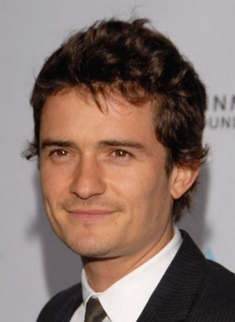 Orlando Bloom with very short curly hair.jpg