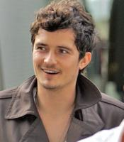 Orlando Bloom with short wavy hair.jpg