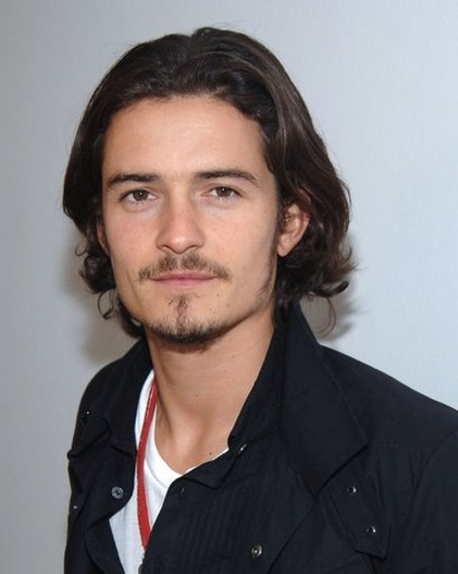 Orlando Bloom with medium wavy hairstyle with long side bang.jpg