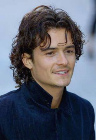 Orlando Bloom with long wavy hairstyle with curly bang.jpg