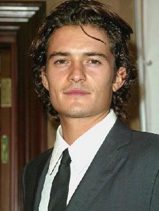 Orlando Bloom with curly long hairstyle with long curly bang.jpg