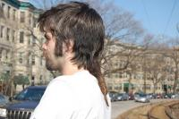men hairstyle with medium length and long the back with layers and long bang.jpg