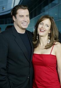 John Travolta his wife.jpg