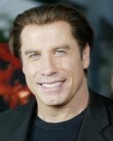 John Travolta short hairstyle with long bangs in the back.jpg