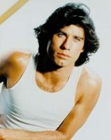 John Travolta with his medium long wavy hairstyle with side bangs_very sexy looking men.jpg