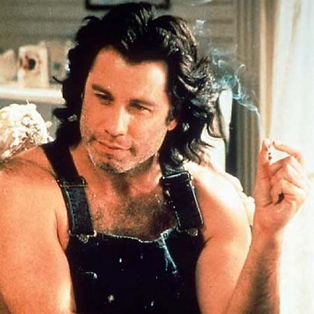 cute looking actor John Travolta with medium long curly and wavy hairstyle with long side bangs.jpg