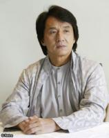 Jackie Chan with medium haircut with long side bangs.jpg