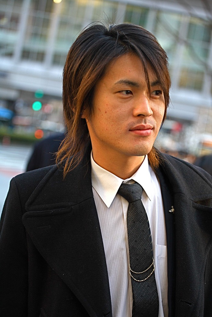 Photograph of medium long layered Asian men hairstyle