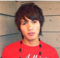 Medium short Asian men haircut with layers and long side bangs.jpg