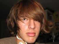 medium teen guy hairstyle with layers and swept bang.jpg