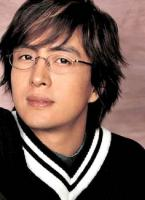 Asian actor Bae Yong Joon with layered medium long haircut