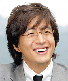 Bae Yong Joon actor with medium long layered hairstyle with long side bangs