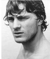sexy actor Jamie Dornan picture with curly hairstyle with and long bangs.JPG