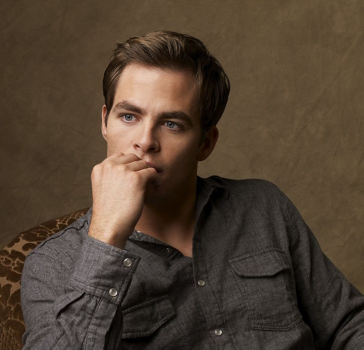 Actor Chris Pine post picture with his classic hairstyle.JPG